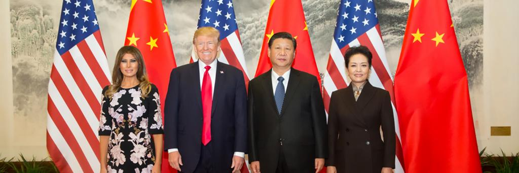 Donald Trump poses for a photo with Xi Jinping of China