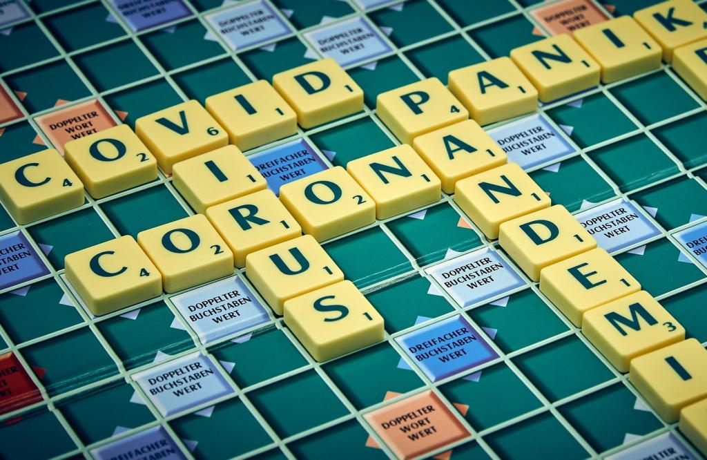 Scrabble game showing the words covid, virus, corona and pademic