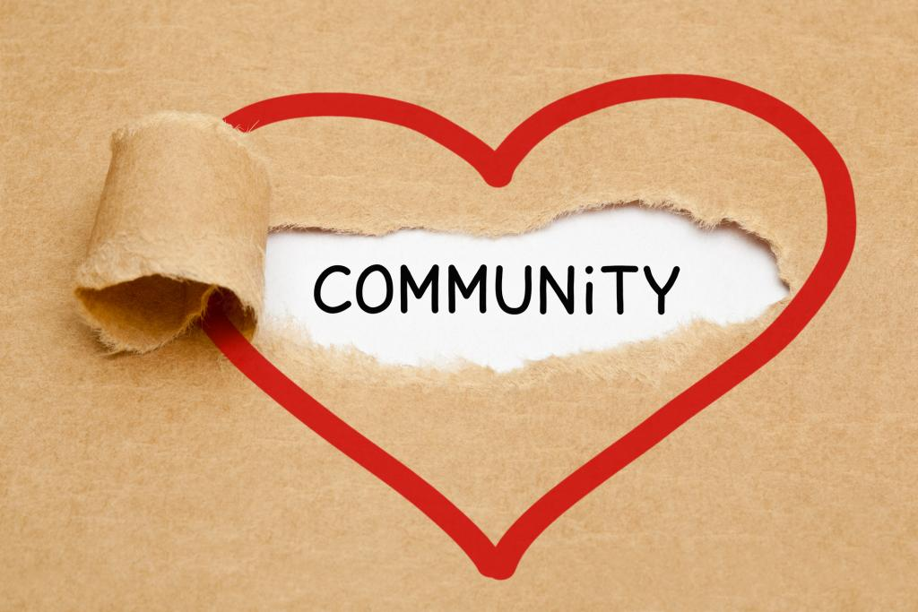 the word community is written in a heart