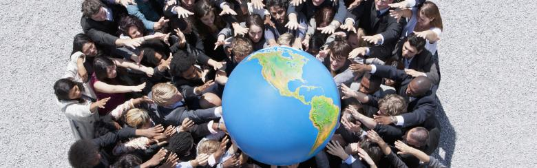 People gather together to hold a globe