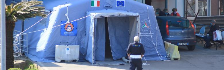 A triage tent set up in front of an Italian hospital.