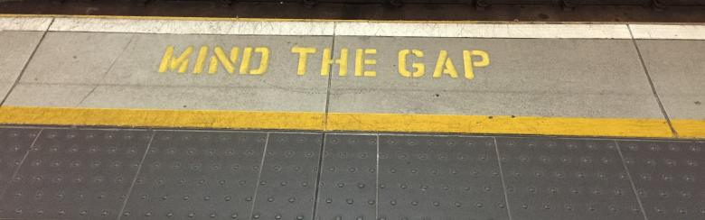 "Photo of the ""mind the gap"" sign at the subway"