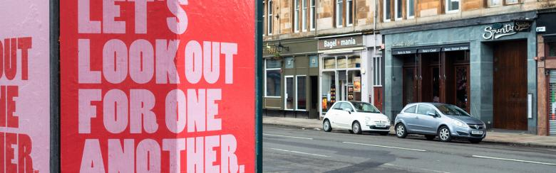 A sign reads Let's look out for one another.