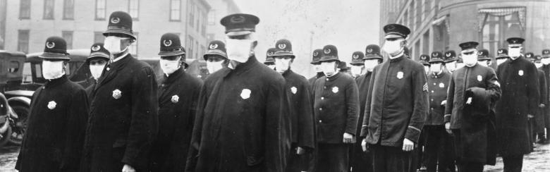 seattle policemen wear masks to protect from the Spanish Flu of 1918