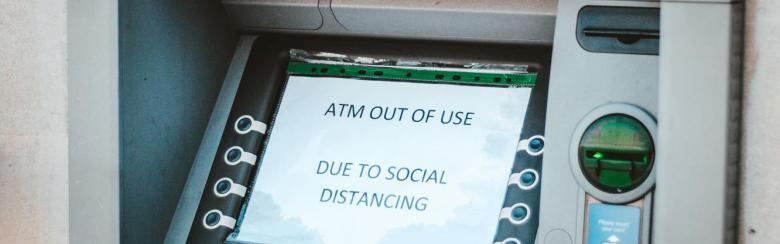"ATM with a message that reads ""out of use due to social distancing"""