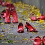 Red shoes united against violence on women © MikeDotta / Shutterstock.com